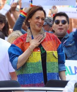 US Senator and Vice President Kamala Harris standing in crowd wearing Gay Pride Rainbow Flag Bedazzled Denim Jacket and passing a lively and lovely smile to her fans and supporters